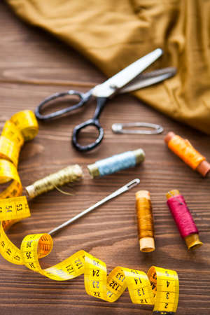Tailor dummy with measuring tapes in fashion studio, close up