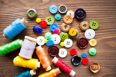 Tailoring. The process of creating the design model. Pattern cutting scissors, fabric, patterns, tape measure, spools of thread, buttons need sewing clothes. Items for tailoring.