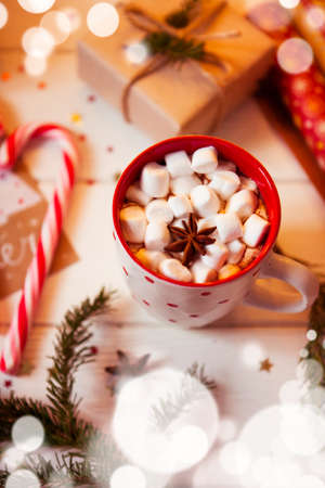 Cup of hot Chocolate drink with Marshmallows and cinnamon on wooden background with Christmas decorations. Winter time. Holiday concept, Selective focus