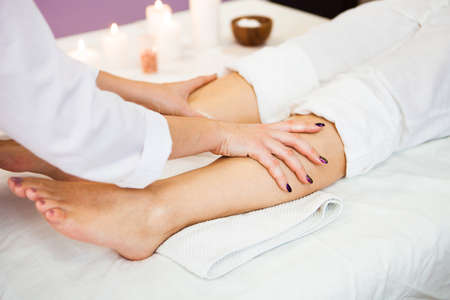 Beautiful young woman relaxing with hand massage at beauty spa salon. Close-up, Spa treatment. Ð¡oncept of health