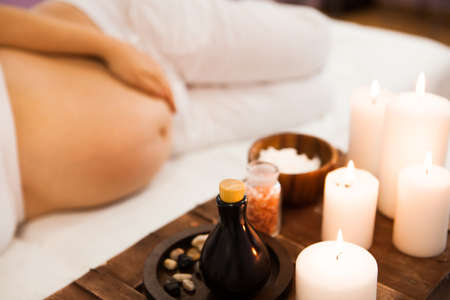 Young pregnant woman relaxing at Spa salon, Spa treatment. Сoncept of beauty and health 스톡 콘텐츠