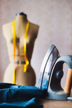 Close up of professional iron in a tailor's factory, tailoring theme, copy space