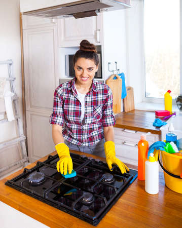 Beautiful young woman makes cleaning the house. Girl cleaning kitchen. Set.