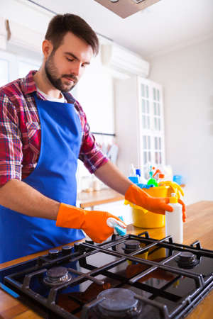 Man makes cleaning the kitchen. Young man washes an oven. Cleaning concept. Set.