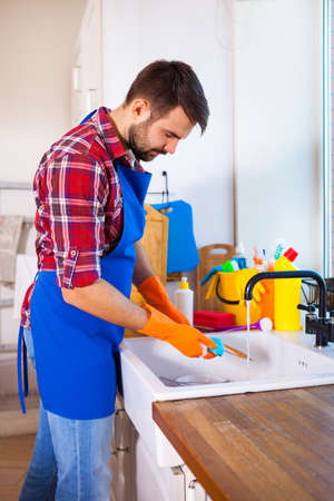 Man makes cleaning the kitchen. Young man washes the dishes. Cleaning concept. Set.