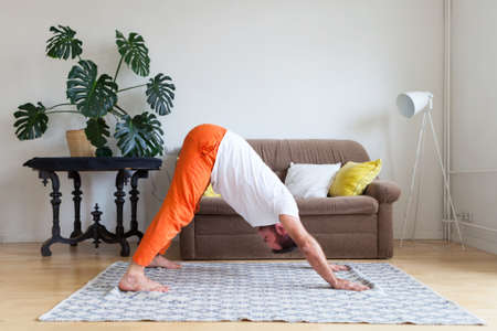 Man practicing yoga and meditation at home. A series of yoga poses. Lifestyle concept. Foto de archivo