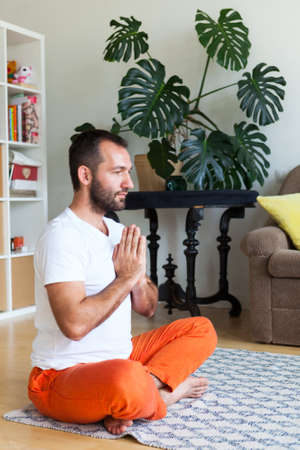 Man practicing yoga and meditation at home. A series of yoga poses. Lifestyle concept. Reklamní fotografie
