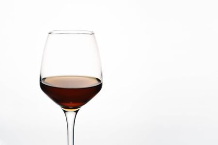 Beautiful glass of red wine on white background close-up