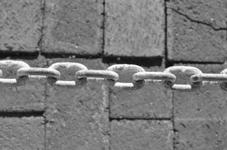 Black and white photo of a chain links closeup photo