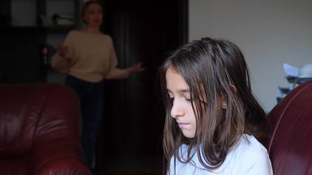 Mom scolds her daughter in her room, space for copying