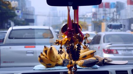 Bangkok, Thailand. January 7, 2019. view from the car window. Garland of flowers on the windshield of the car.
