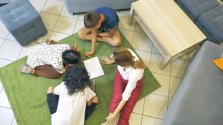 The concept of childrens group psychotherapy. female psychologist conducts a group consultation with adolescents in a stylish office. back to school, learning problems .