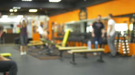 blurred background. people involved in sports in the gym for fitness, interior of new modern equipment, sport concept Zdjęcie Seryjne