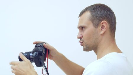 male professional photographer emotionally communicates with a model and takes a photo,