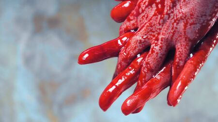 bloody hands, blood dripping from his hands. copy space