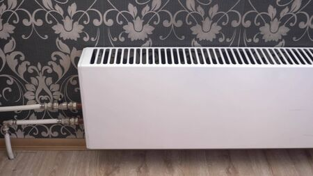 convection battery in the apartment walls with black and white Wallpaper Фото со стока