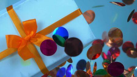 closeup. gift box and confetti under water. fashion design background.