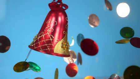 red bell on a blue background and confetti. gala fashion design background.
