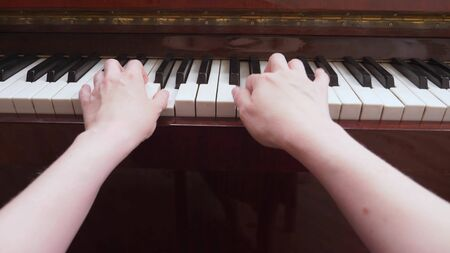 closeup. female hands play the classical piano. copy space