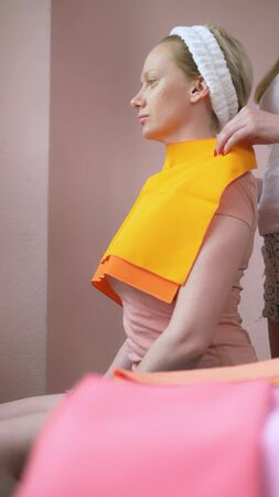 vertically. the stylist conducts a color type procedure for a woman Banco de Imagens