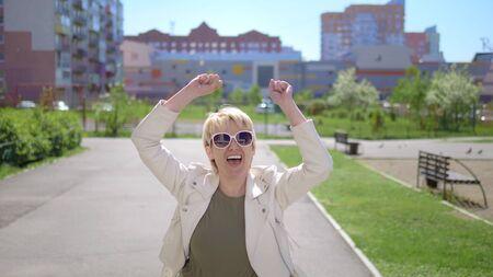 beautiful stylish woman happily dances on the streets of the city Zdjęcie Seryjne
