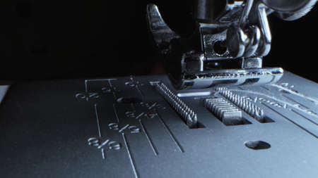 extreme close-up, detailed. iron needle of electric sewing machine