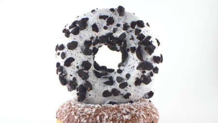 Close-up, detailed. donut with white icing and chocolate chips. White background 版權商用圖片