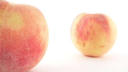 extremely close-up, detailed. ripe peaches on a white background