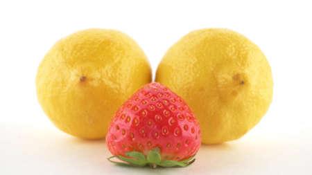 Close-up isolated on white background lemon and strawberry