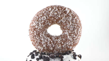 chocolate donut with coconut flakes on isolated white background. details 版權商用圖片