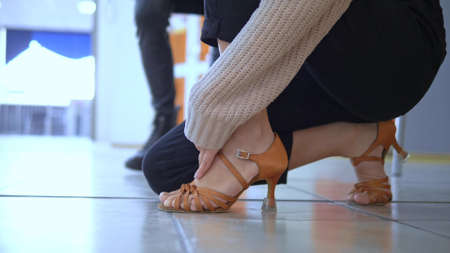 Close-up of a girl putting on shoes for ballroom dancing Stock fotó