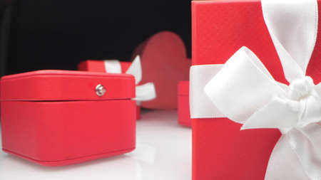 extremely close-up, detailed. red jewelry gift boxes with white ribbon Reklamní fotografie