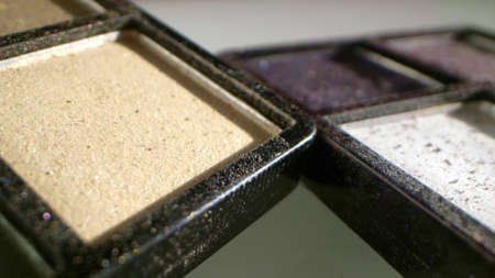 extremely close-up, detailed. palette with used cosmetics