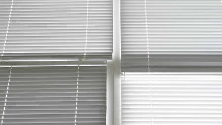 background texture. closed white aluminum blinds on windows Banque d'images