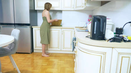 unrecognizable woman cleans up her kitchen. copy space