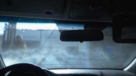 close-up. white foam on the car glass. car wash . copy space Banque d'images