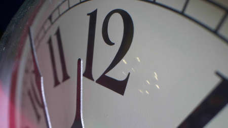 as close-up as possible, detailed. the hands of the clock at 11 hours 55 minutes on the alarm clock