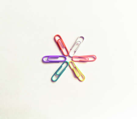 Colorful office paperclips in the form of a flower.