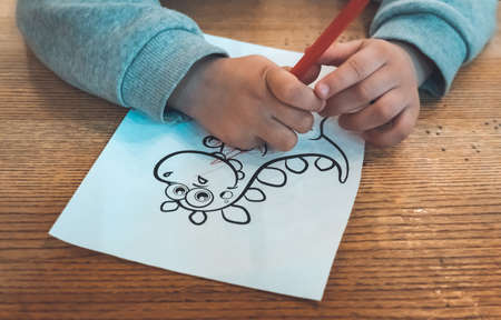 Close-up of kid hands coloring drawing. Stok Fotoğraf - 131728807