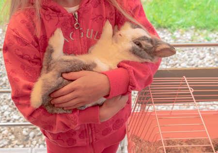 Little girl holding a cute fluffy Bunny.