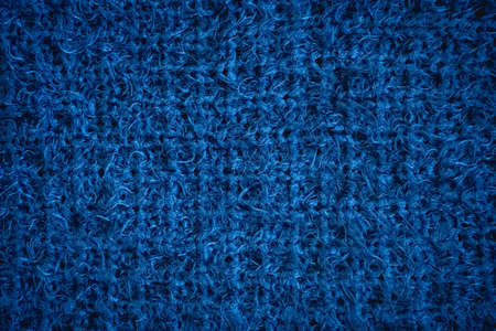 The color of the year 2020. Dark blue knitted texture.