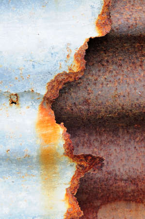 oxidated: corroded fence made of corrugated iron Stock Photo