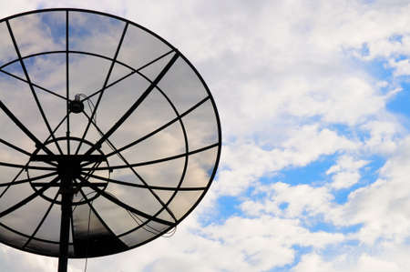 Sattelite dish in the cloudy sky Stock Photo