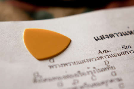 songbook: Guitar pick and songbook Stock Photo