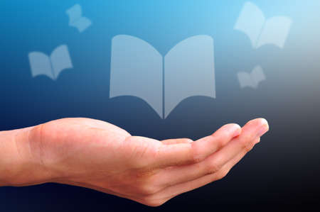 obtain: hand with floating book Stock Photo
