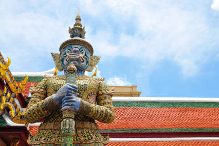 Giant guard of Emerald Buddha temple, the famous place to visit in Thailand photo