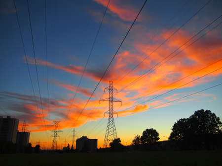 Electric post in a field and colorful sky Stock Photo