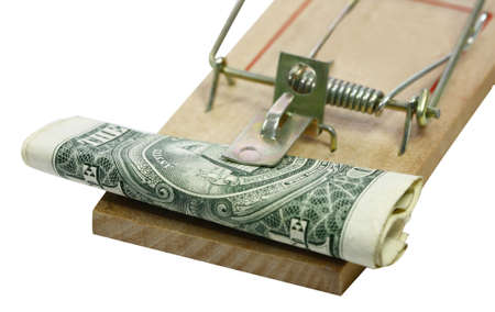 a roll of paper money and a mouse trap photo