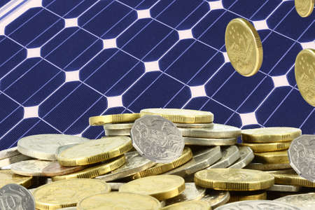 electric cell: solar panel  and a heap of gold  coins