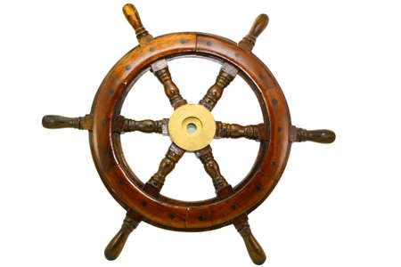 an old boat steering wheel on white background photo